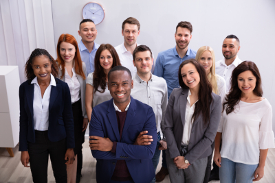 group of young business professionals standing in office